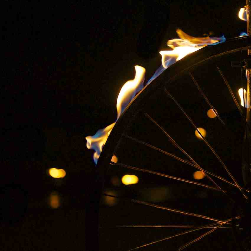 Close up of a bike wheel with the tire aflame